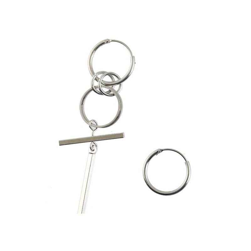 Asymmetric Earrings with cross pendant and rings 45